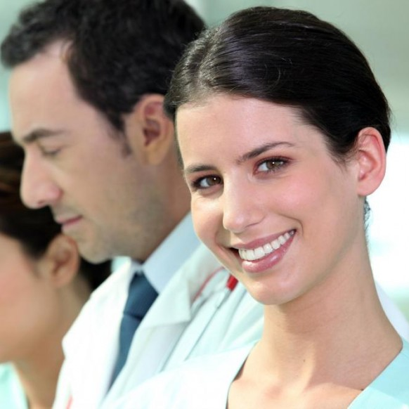 smiling-hospital-nurse-standing-with-colleagues